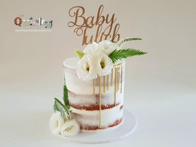 White floral Naked cakewith Gold drip