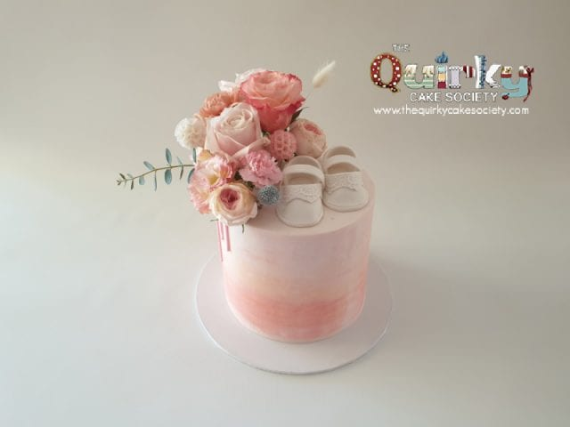 Apricot blush booties buttercream cake
